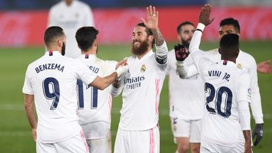 Real Madrid beat Granada to move level on points with Atletico Madrid at the top of La Liga
