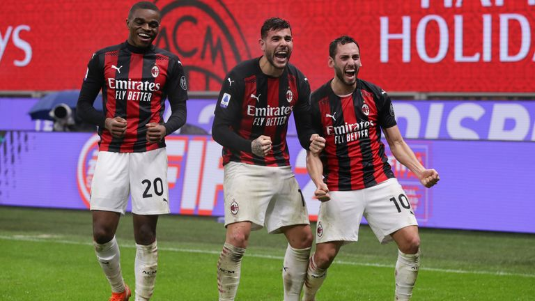Theo Hernandez with team-mates Hakan Calhanoglu and Pierre Kalulu after heading AC Milan's winner