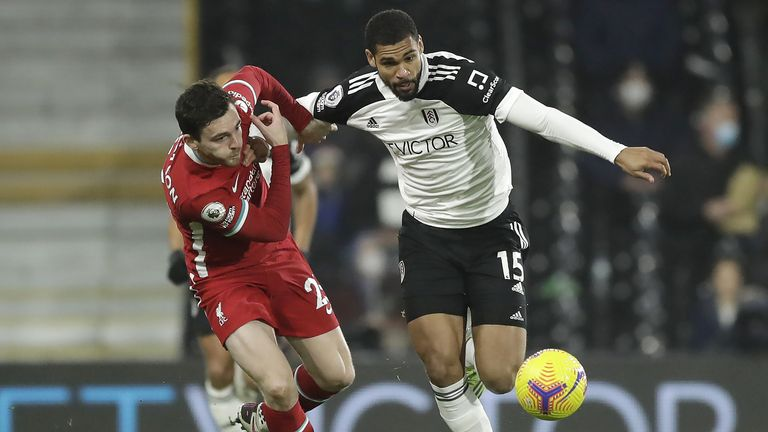 Liverpool's Andrew Robertson (left) and Fulham's Ruben Loftus-Cheek battle for the ball