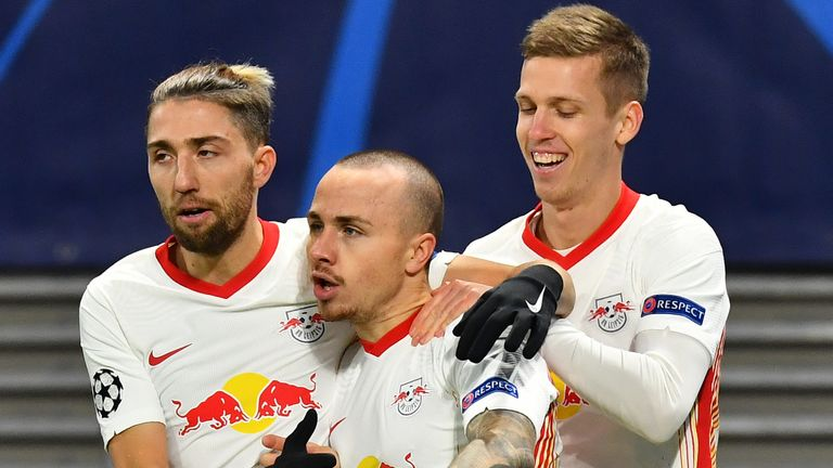 Angelino celebrates scoring for RB Leipzig against Manchester United