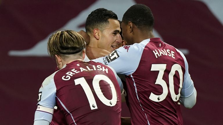Anwar El Ghazi celebrates scoring Villa's third with his team-mates