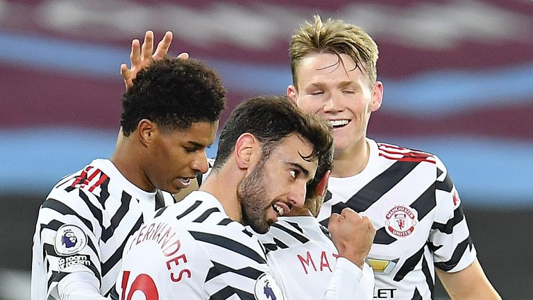 Manchester United players celebrate during their turnaround victory against West Ham