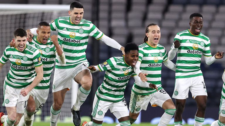 Celtic celebrate as Kristoffer Ajer scores the winning penalty against Hearts