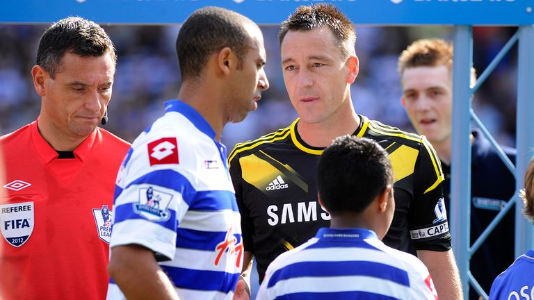 Anton Ferdinand refuses to shake hands with John Terry in a game between QPR and Chelsea in 2012