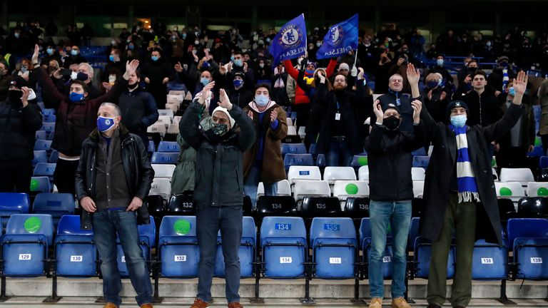 Fans applaud the players of Chelsea as they warm up prior during the Premier League match between Chelsea and Leeds United at Stamford Bridge