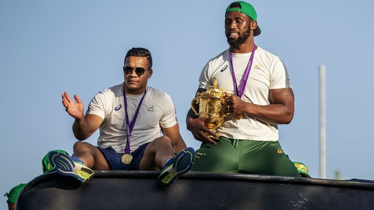 Cheslin Kolbe and Siya Kolisi celebrate the Springboks' World Cup win in 2019