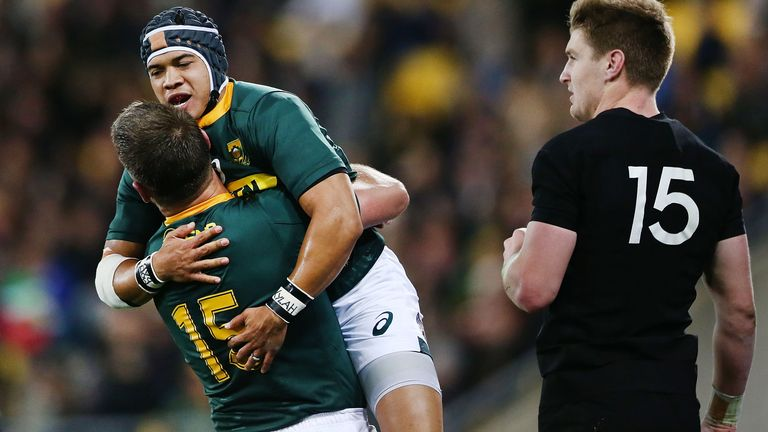 Cheslin Kolbe is congratulated by Willie le Roux after scoring his first Test try