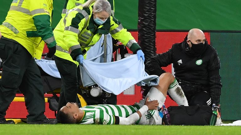 Celtic's Christopher Jullien collides with the goalposts and suffers an injury