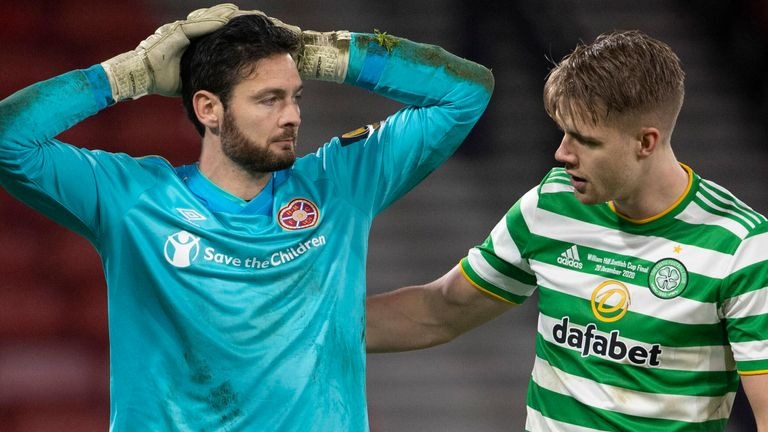 Kristoffer Ajer talks to former team-mate Craig Gordon after Celtic beat Hearts in the Scottish Cup final