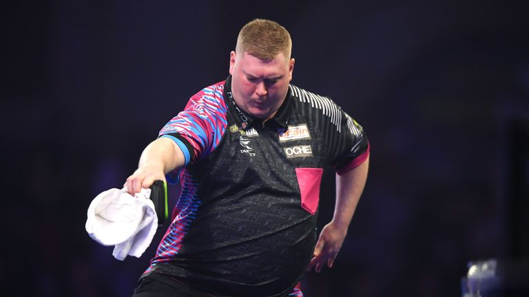 Ricky Evans celebrates victory during the round 2 match between Ricky Evans and Mark McGeeney on Day 8 of the 2020 William Hill World Darts Championship at Alexandra Palace on December 20, 2019 in London, England.