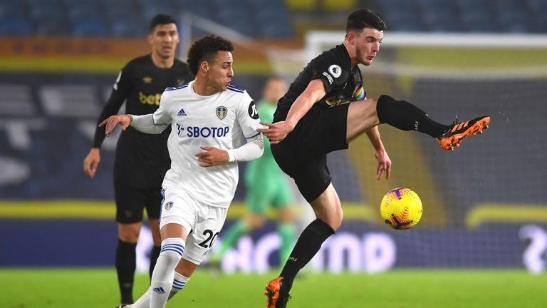 Decland Rice battles for the ball against Rodrigo