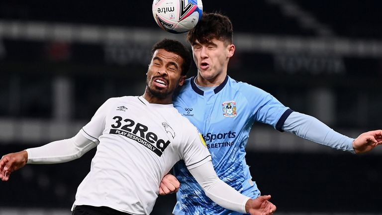 Nathan Byrne of Derby County battles for a header with Ryan Giles of Coventry City
