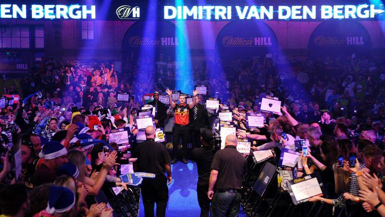 Dimitri Van den Bergh makes his entrance at the World Darts Championship last year