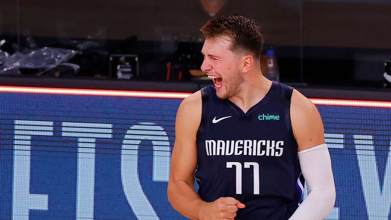Luka Doncic #77 of the Dallas Mavericks celebrates a game winning three point basket against the LA Clippers during overtime in Game Four of the Western Conference First Round during the 2020 NBA Playoffs