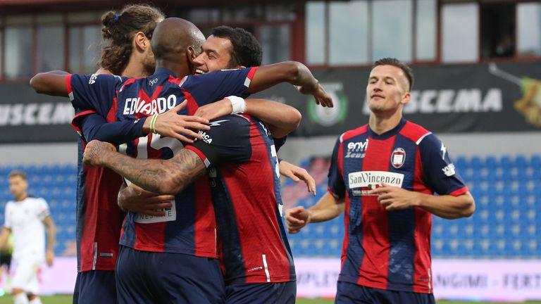 Eduardo Henrique celebrates with team-mates after scoring