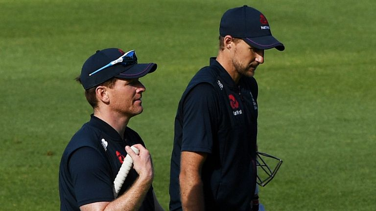 England captain Eoin Morgan leaves the field with team mate Joe Root