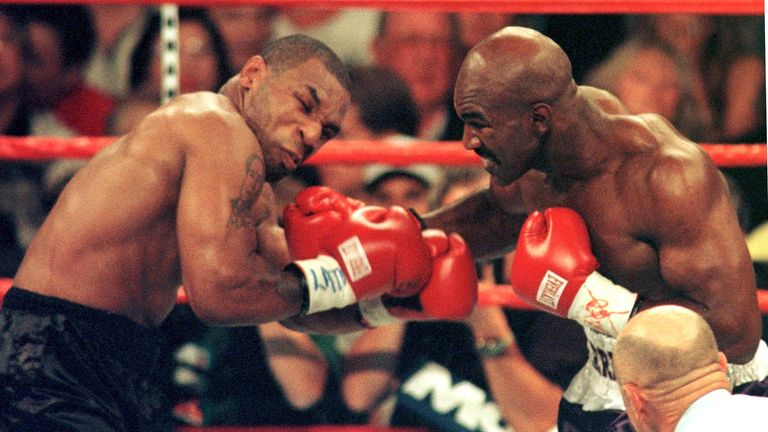 Evander Holyfield stopped Mike Tyson in the 11th round of their first meeting in 1995