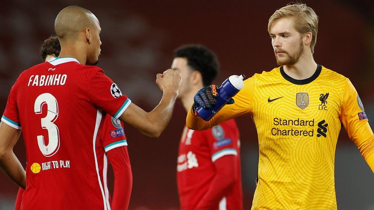 Fabinho fist bumps Caoimhin Kelleher prior to Liverpool's Champions League game versus Ajax