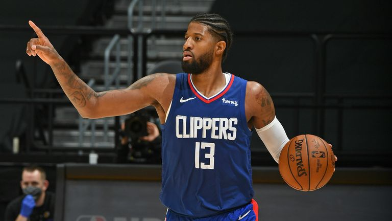 Paul George #13 of the LA Clippers dribbles the ball up court against the Los Angeles Lakers on December 22, 2020