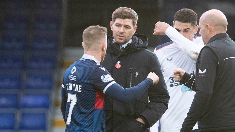 Rangers manager Steven Gerrard speaks with Michael Gardyne at full time