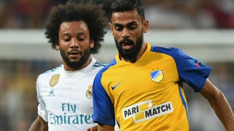Real Madrid's defender from Brazil Marcelo (L) vies with APOEL Nicosia's aforward from Norway Ghayas Zahid during the UEFA Champions League football match Real Madrid CF vs APOEL FC at the Santiago Bernabeu stadium in Madrid on September 13, 2017.
