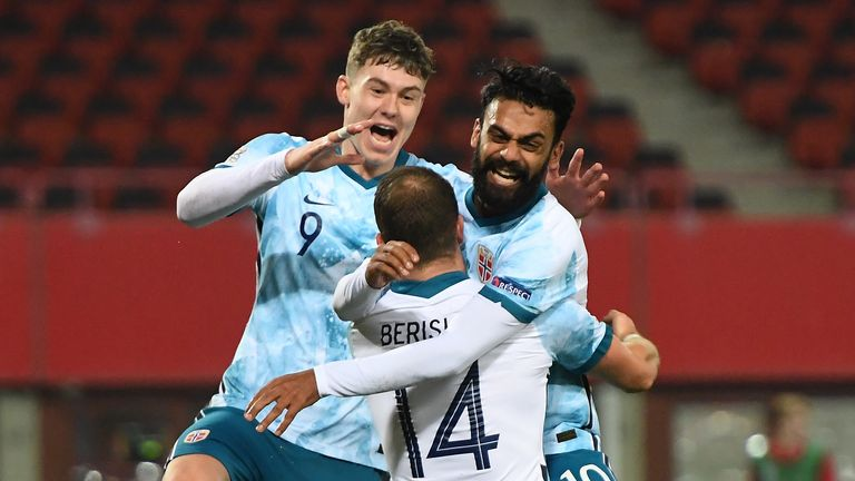 Norway's forward Veton Berisha (C) Norway's midfielder Ghayas Zahid (R) and Norway's forward Jorgen Strand Larsen (L) celebrates scoring the opening goal vie for the ball during the UEFA Nations League football match Austria v Norway on November 18, 2020 in Vienna