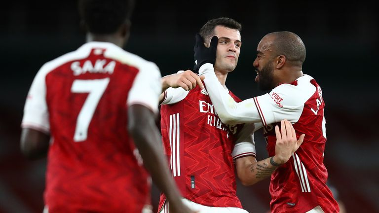 Granit Xhaka celebrates after doubling Arsenal's lead