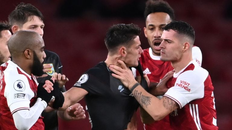 Granit Xhaka appears to grab Ashley Westwood by the throat before his sending off