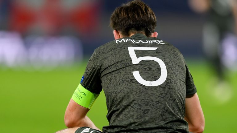 Harry Maguire looks dejected after Manchester United's defeat to RB Leipzig in the Champions League
