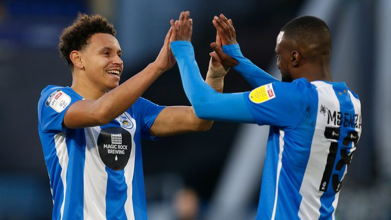 Huddersfield's Ramani Edmonds-Green and Isaac Mbenza celebrate after the Terriers' 2-0 win over Watford