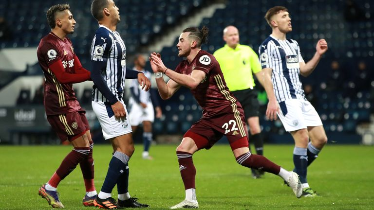 Jack Harrison celebrates scoring Leeds' third