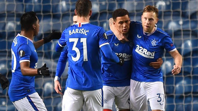 James Tavernier is congratulated after hauling Rangers level at 2-2
