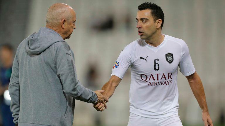 O veterano técnico português Jesualdo Ferreira com Xavi Hernández