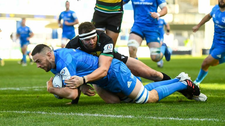 Josh Murphy of Leinster scores his side's first try despite the attempted tackle from Tom Wood