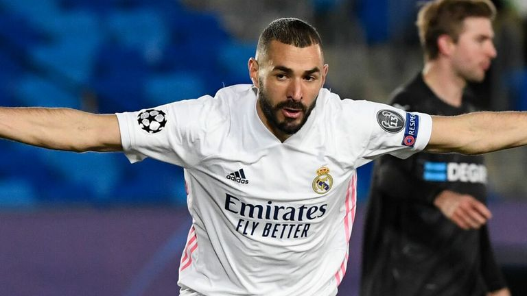 Karim Benzema wheels away in delight after his early goal in Madrid