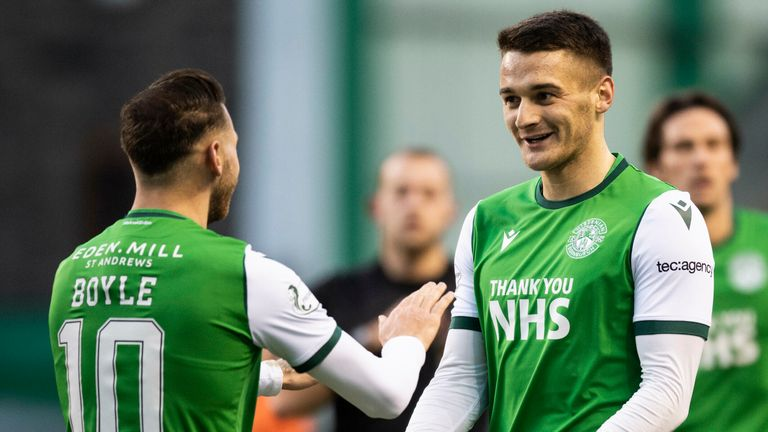 Kyle Magennis celebrates his goal for Hibernian against Dundee United