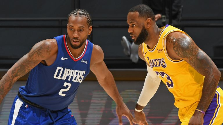 Kawhi Leonard #2 of the LA Clippers and LeBron James #23 of the Los Angeles Lakers stand on the court on December 22, 2020