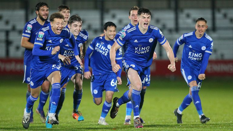 Darragh O'Connor of Leicester City U21 and team mates celebrate after winning a penalty shoot against Salford City
