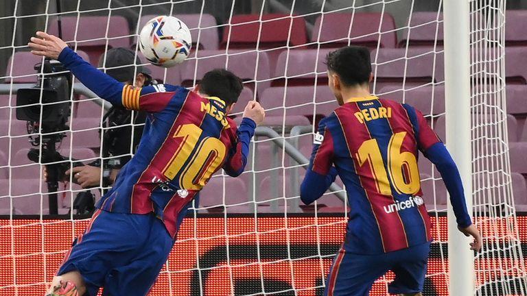 Lionel Messi scores for Barcelona against Elche