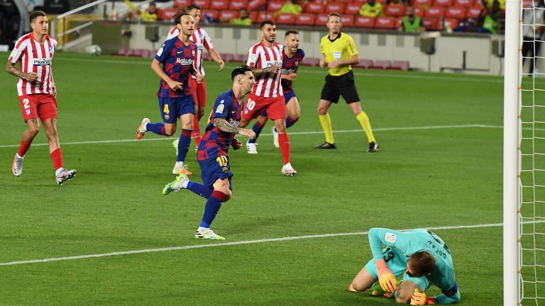Lionel Messi of FC Barcelona celebrates after scoring his team's second goal by penalty against Goalkeeper Jan Oblak of Atletico Madrid during the Liga match between FC Barcelona and Club Atletico de Madrid at Camp Nou on June 30, 2020 in Barcelona, Spain