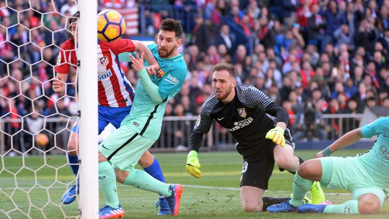 Filipe Luis, #3 of Atletico de Madrid and Lionel Messi, #10 of FC Barcelona and Jan Oblak, #13 of Atletico de Madrid during The La Liga match between Club Atletico de Madrid v FC Barcelona - La Liga at Vicente Calderon on February 26, 2017 in Madrid, Spain.