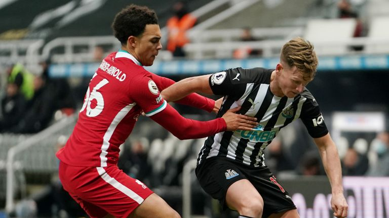 Trent Alexander-Arnold contains Matt Ritchie during a goalless opening period