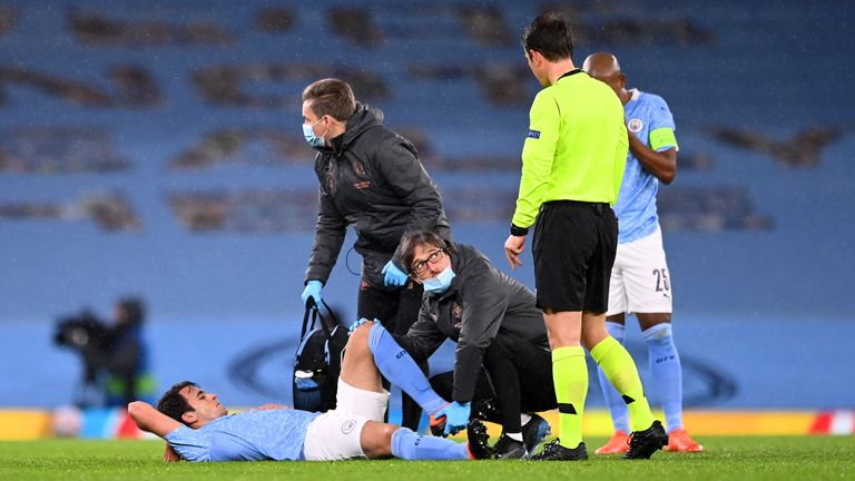 MANCHESTER, ENGLAND - DECEMBER 09: Eric Garcia of Manchester City receives medical treatment during the UEFA Champions League Group C stage match between Manchester City and Olympique de Marseille at Etihad Stadium on December 09, 2020 in Manchester, England. The match will be played without fans, behind closed doors as a Covid-19 precaution. (Photo by Laurence Griffiths/Getty Images)