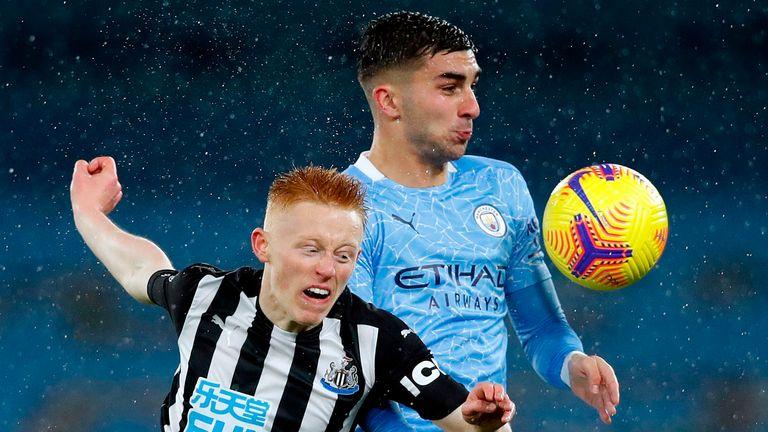 Newcastle United midfielder Matty Longstaff and Manchester City's Fernando Torres face off