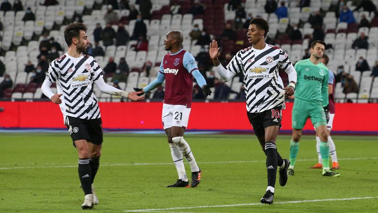Marcus Rashford of Manchester United celebrates scoring their third goal during the Premier League match between West Ham United and Manchester United at London Stadium on December 05, 2020 in London, England. A limited number of fans are welcomed back to stadiums to watch elite football across England.