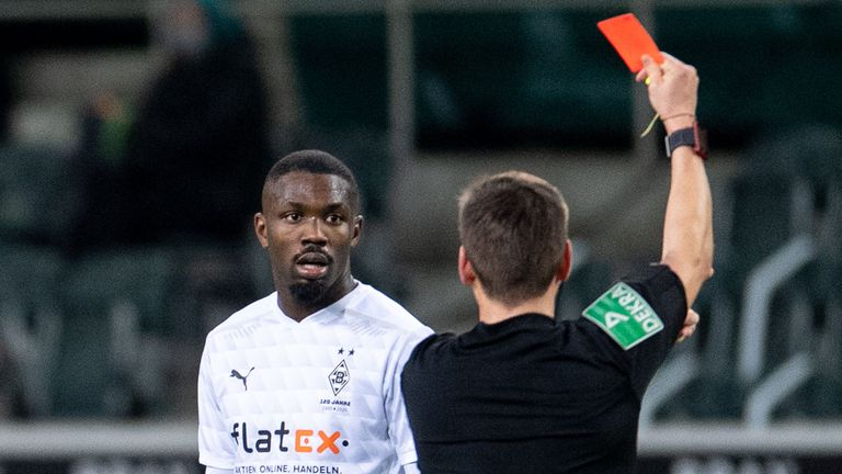 Borussia Moenchengladbach forward Marcus Thuram is red carded after spitting an opponent in their 2-1 defeat to Hoffenheim