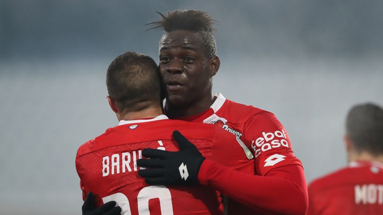 Mario Balotelli celebrates after his goal just four minutes into his debut