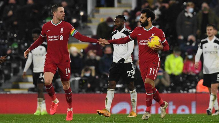 Mohamed Salah celebrates with Jordan Henderson after scoring the equaliser