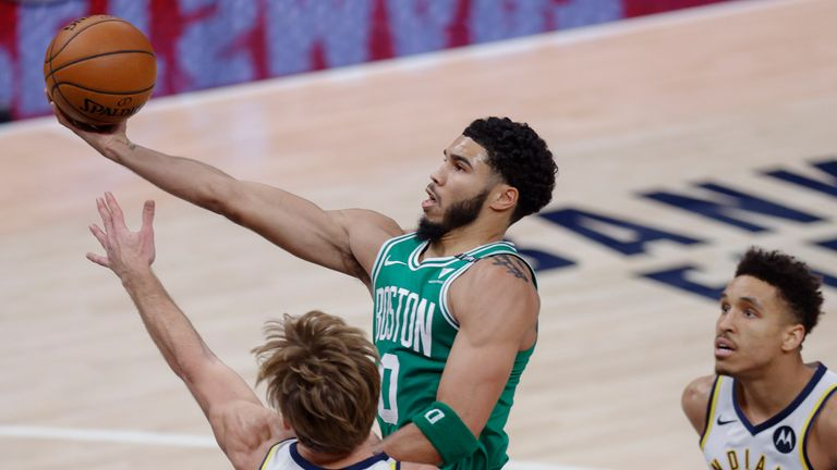 Jayson Tatum #0 of the Boston Celtics shoots the ball against Domantas Sabonis #11 of the Indiana Pacers during the first half at Bankers Life Fieldhouse on December 29, 2020 in Indianapolis, Indiana.