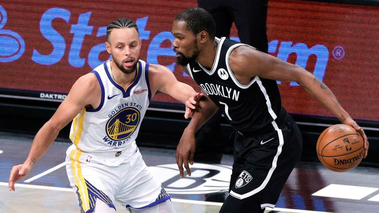 Kevin Durant #7 of the Brooklyn Nets dribbles against Stephen Curry #30 of the Golden State Warriors during the first half at Barclays Center on December 22, 2020
